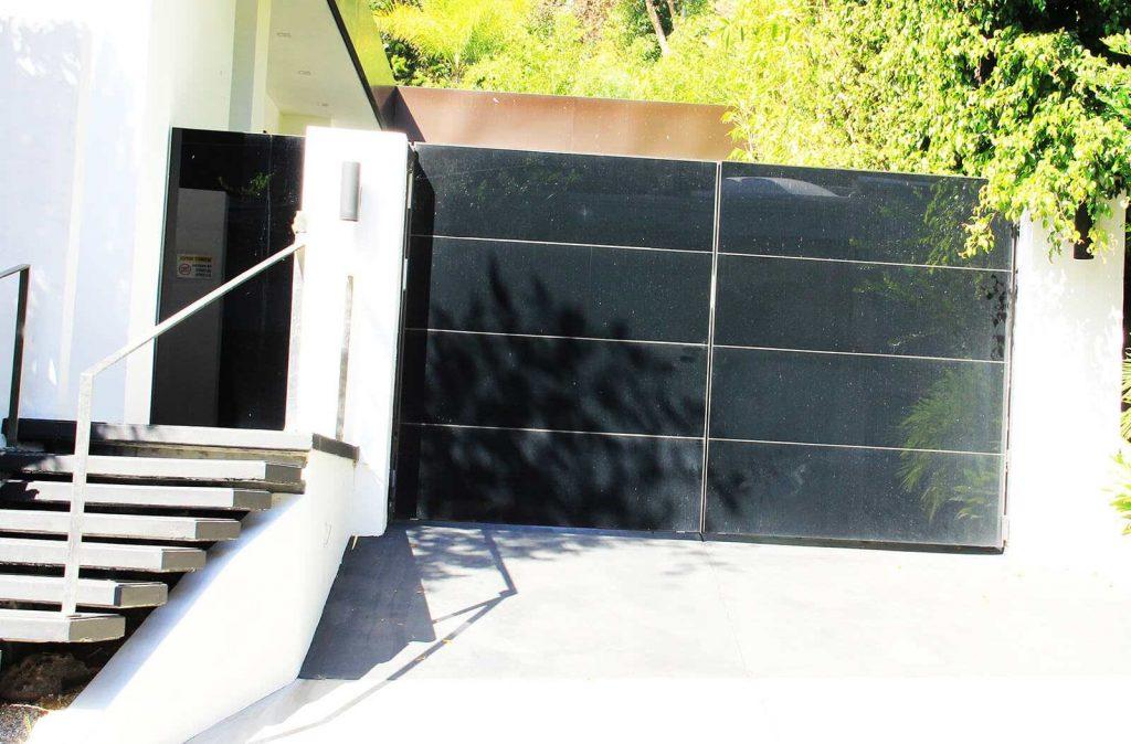 Contemporary black glass bifold auto gate
