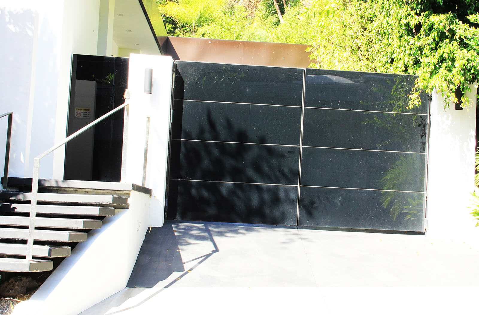 Contemporary black glass bifold auto gate