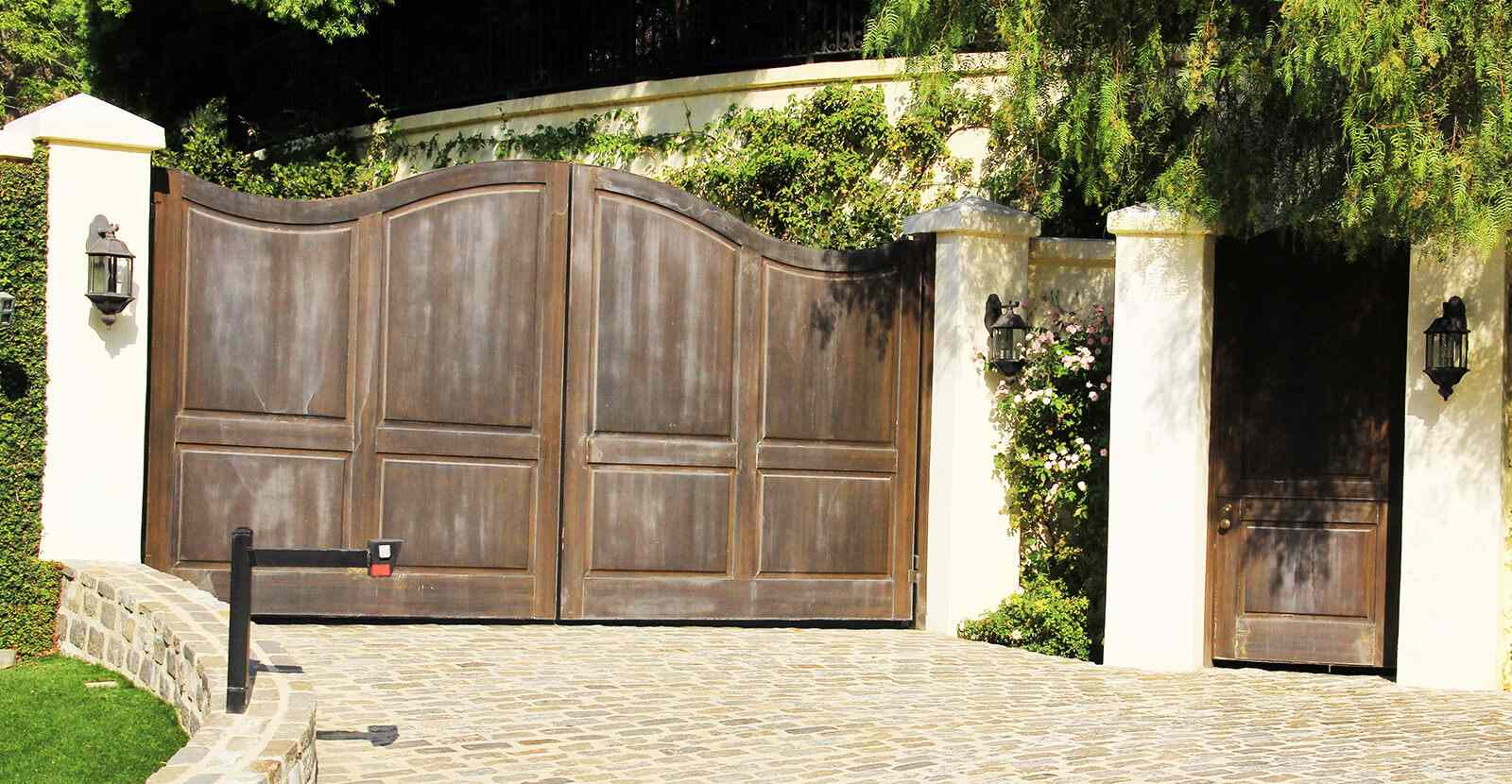 Bifold wood auto and pedestrian gates