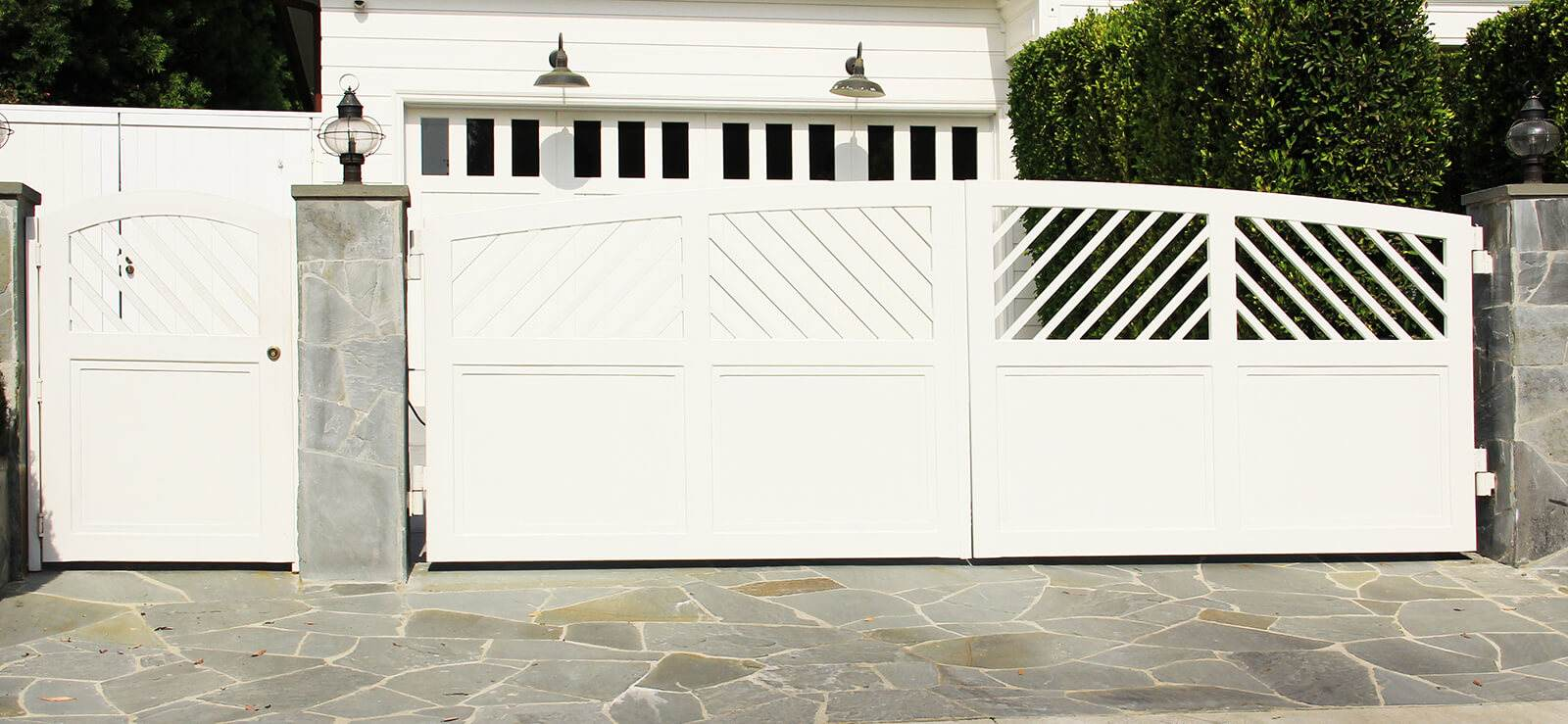 Contemporary wood with custom cut-outs, bifold auto gate and hinged pedestrian gate