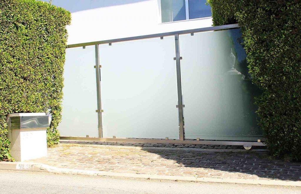 Hillside installed single slide glass and steel gate