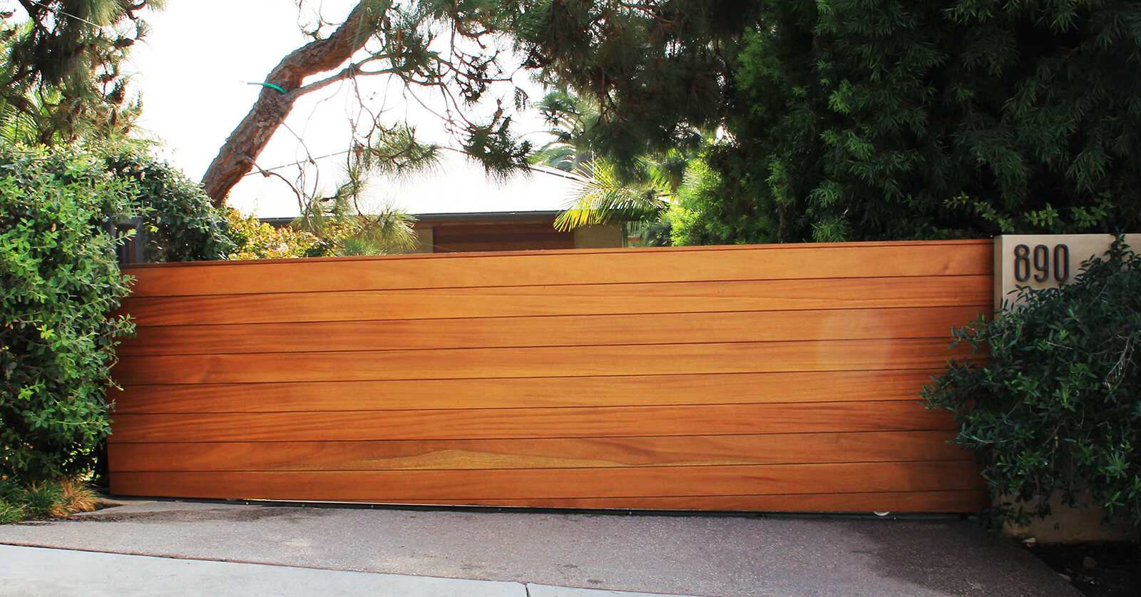 Horizontally clad exotic wood sliding gate