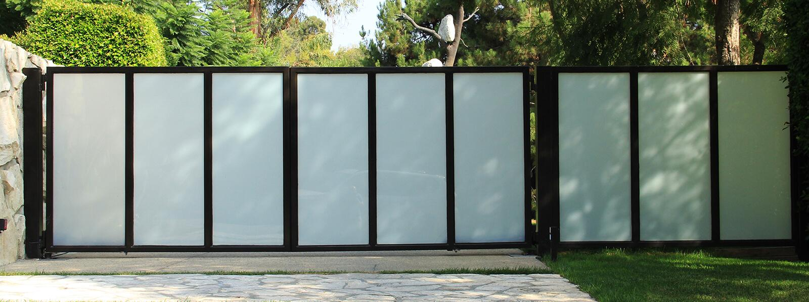 Steel and vertically arranged glass bifold gate