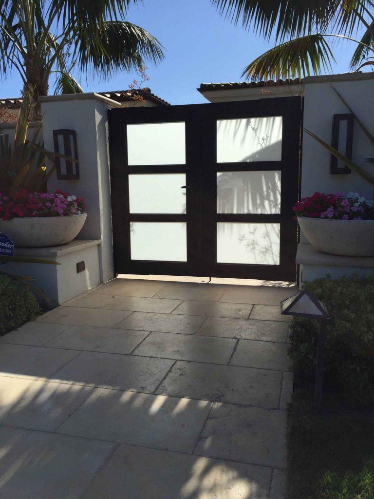 Contemporary wood & glass dual sliding gate