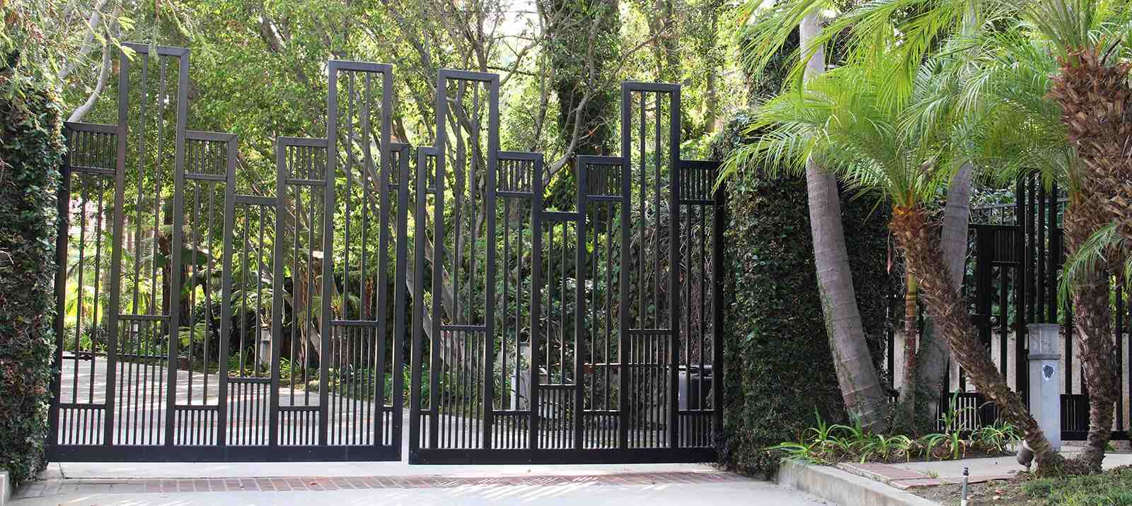Contemporary geometric design bifold steel gate