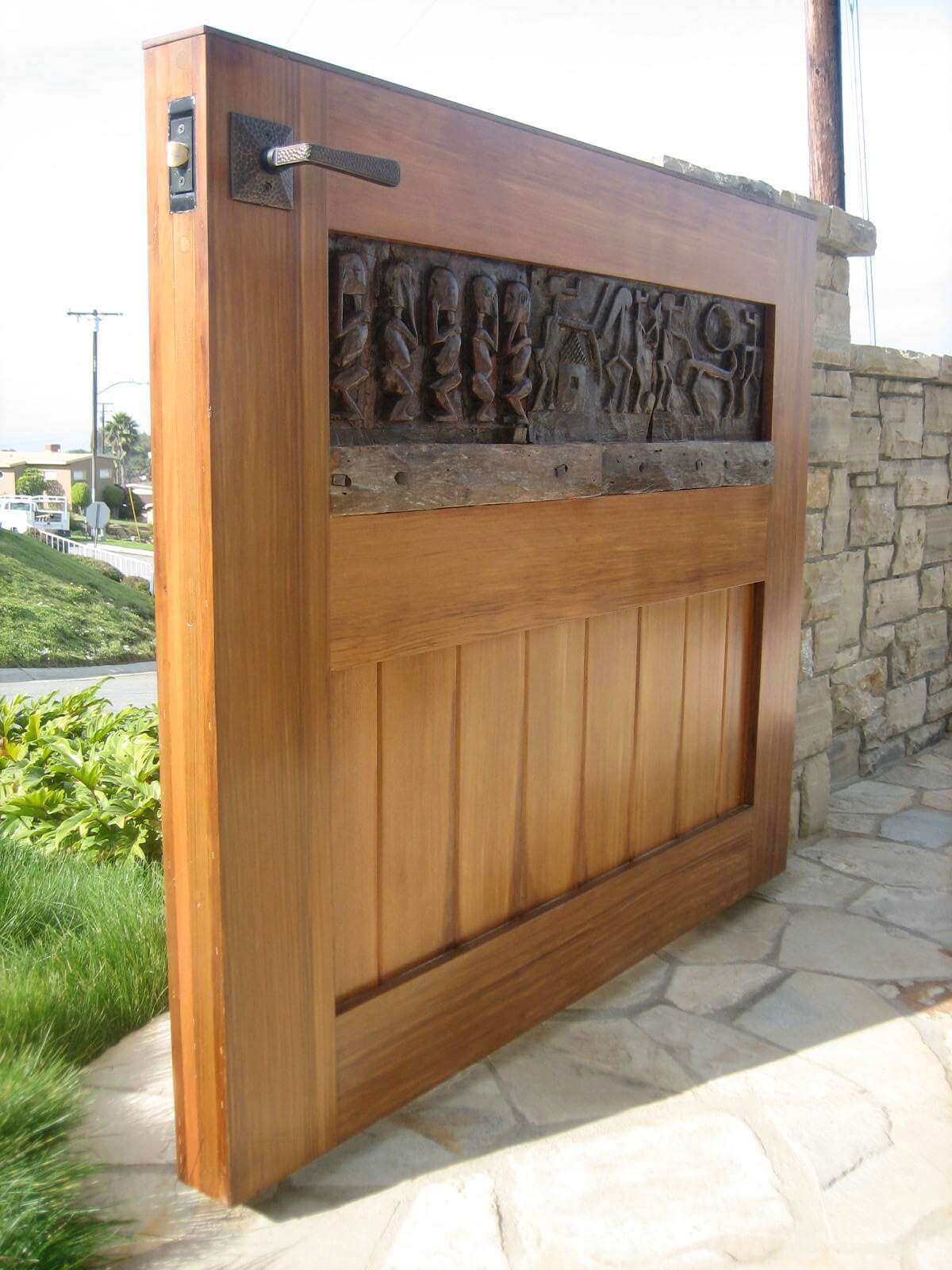 Old world hand carved wood pedestrian gate