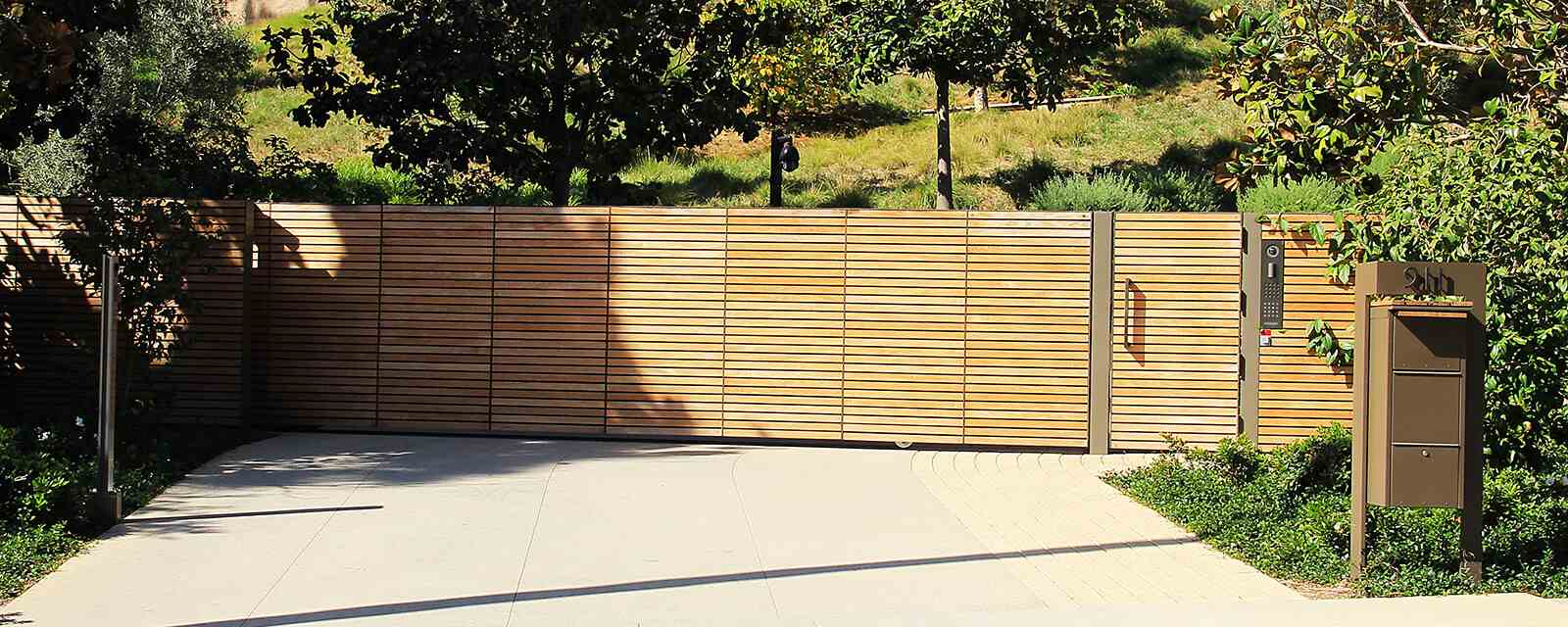 Sustainable teak single slide auto gate and hinged pedestrian gate
