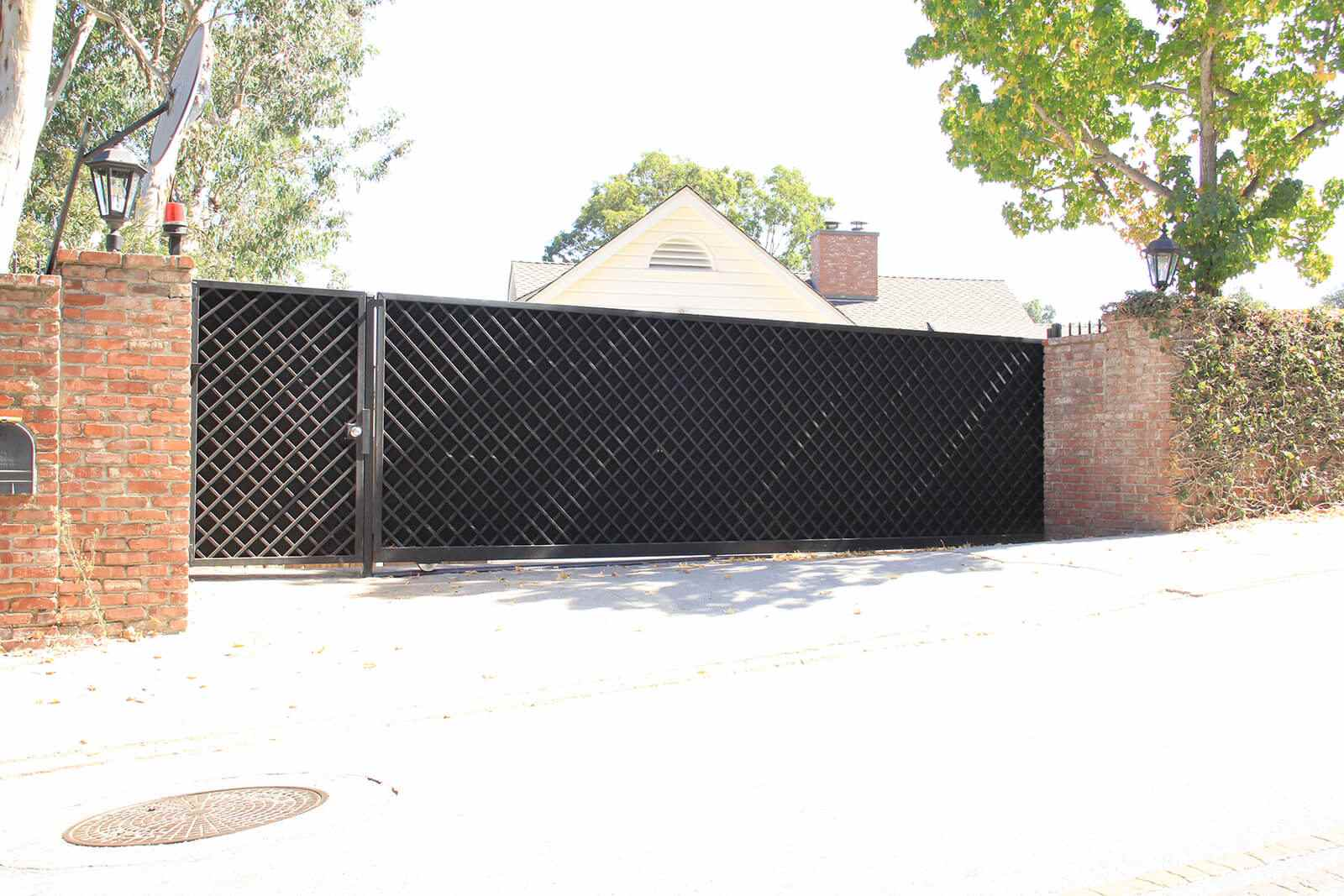 Steel lattice sliding auto and pedestrian gates