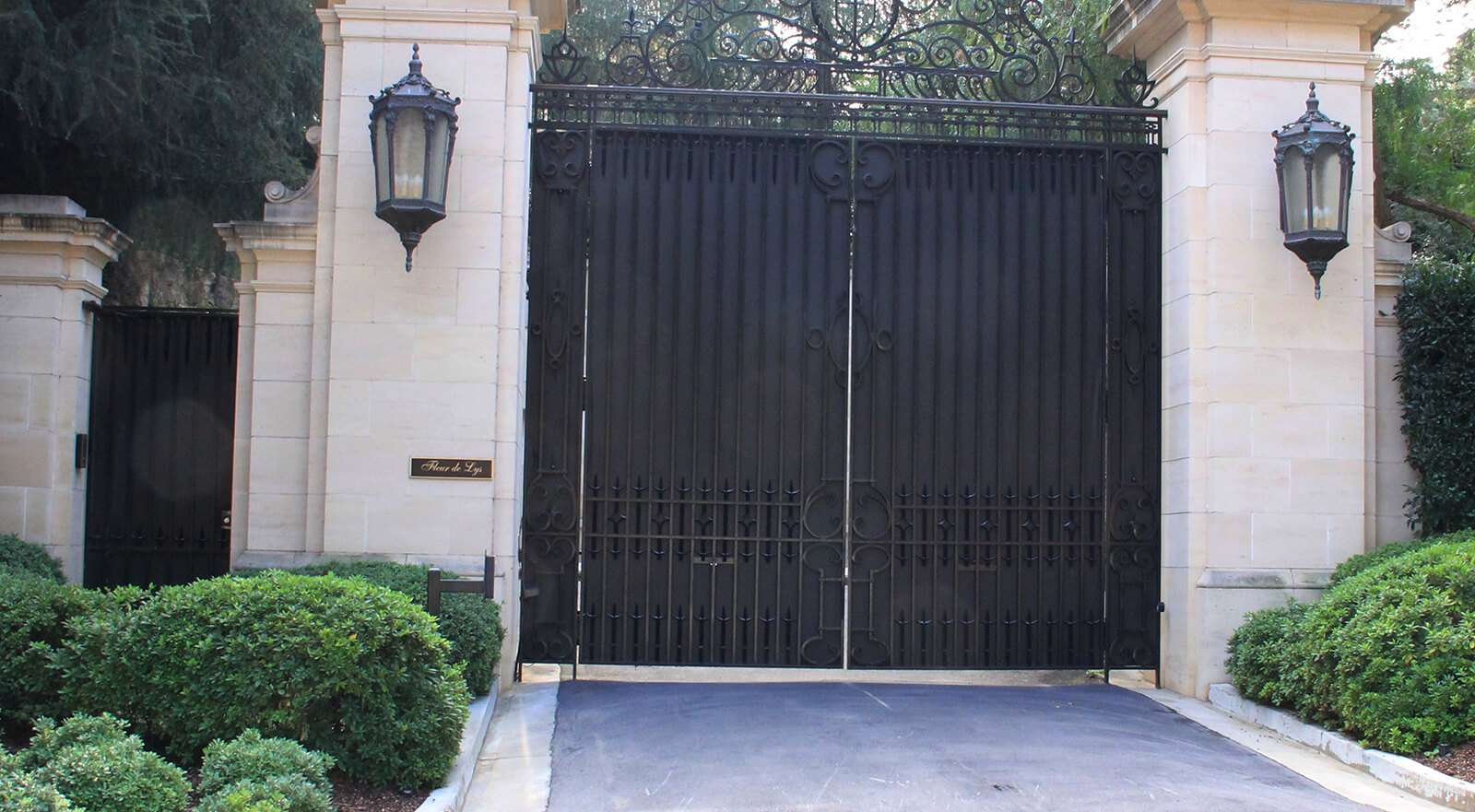 wrought iron and sheet metal bifold auto gate and hinged pedestrian gate