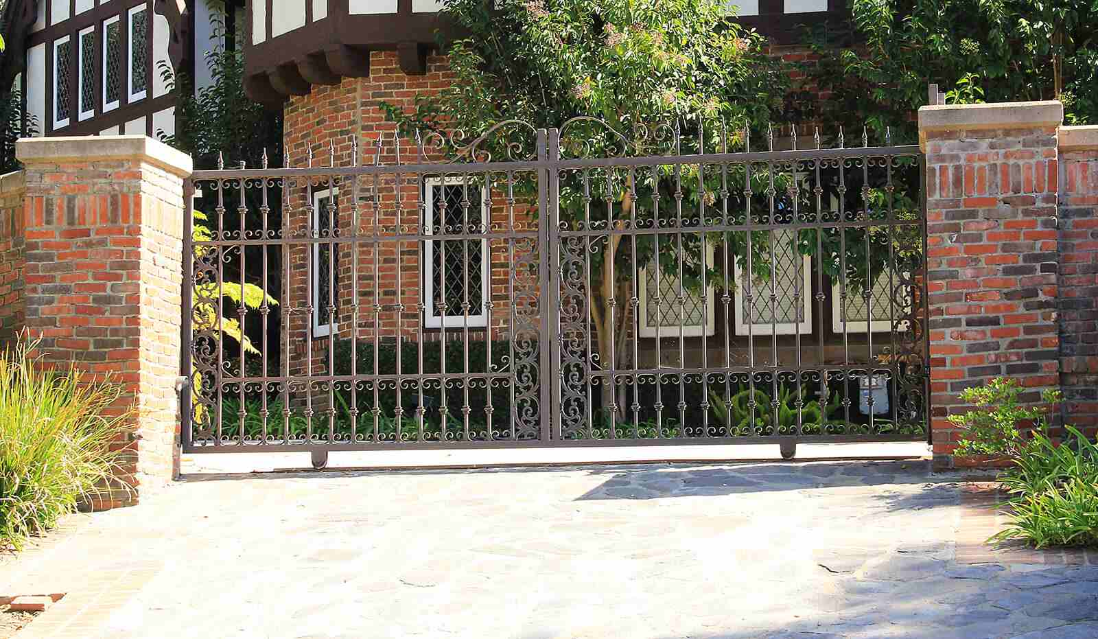Dual slide wrought iron gate