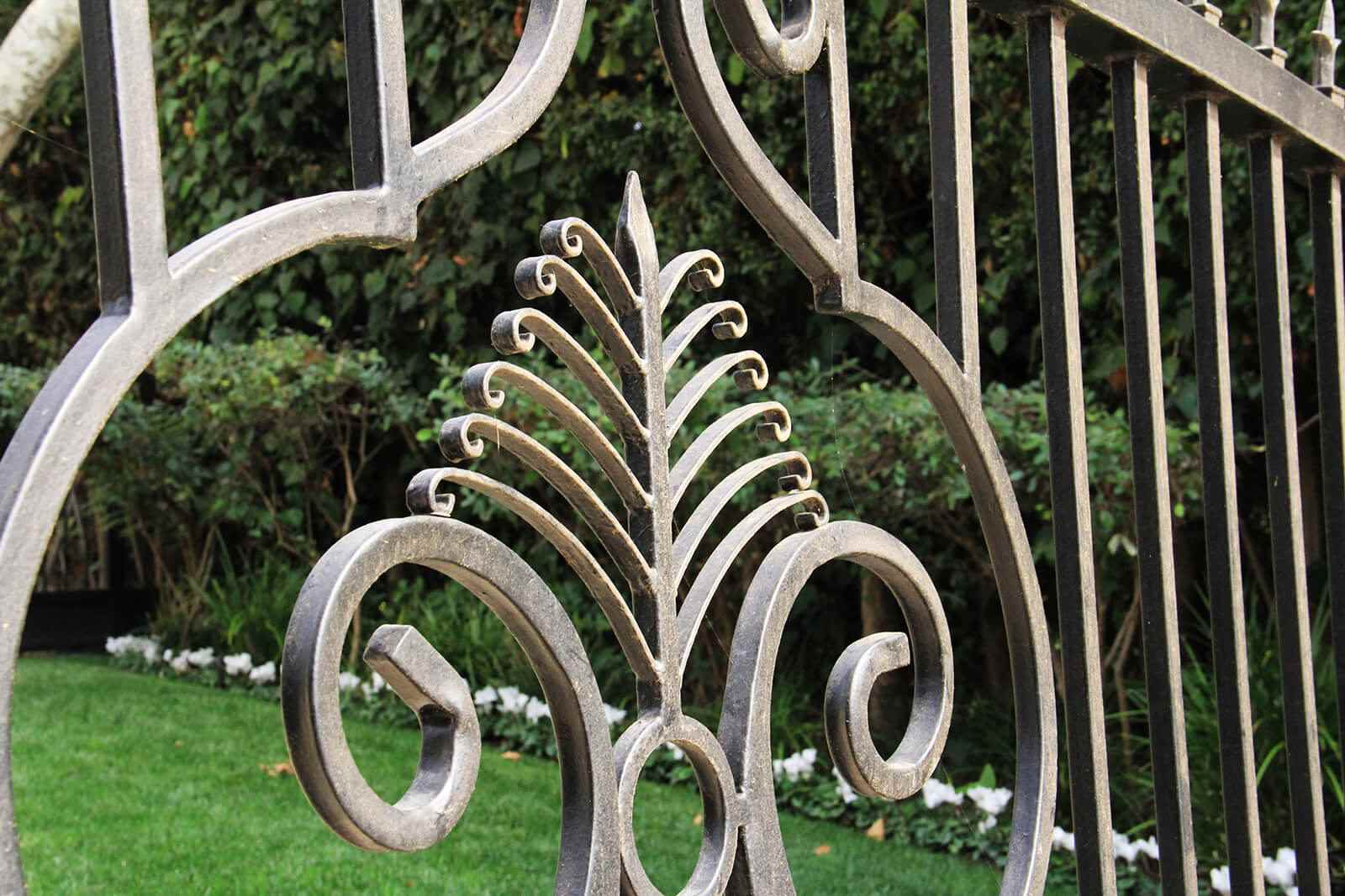 Intricate scroll work on wrought iron gate