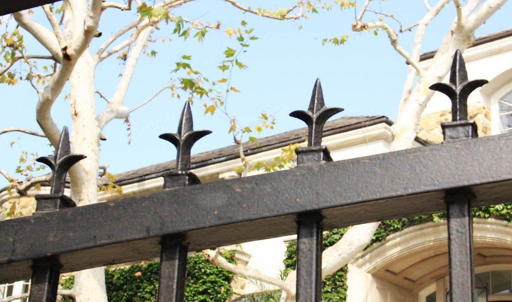 Close up of fleur-de-lis gate topper
